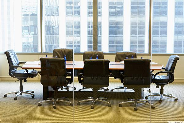 empty board room with brown chairs means higher credit rankings
